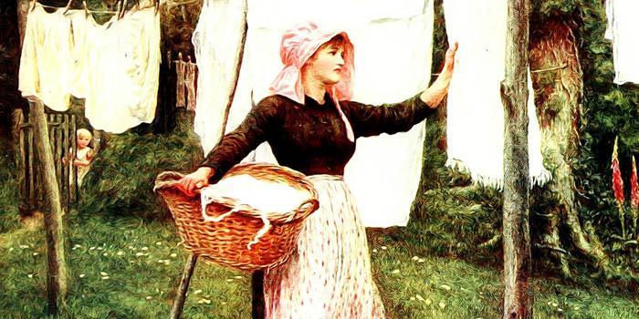 donna che stende le tende bianche lavate
