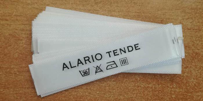 etichetta lavaggio tessuti bianca